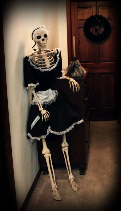 skeleton dressed in waitress costume