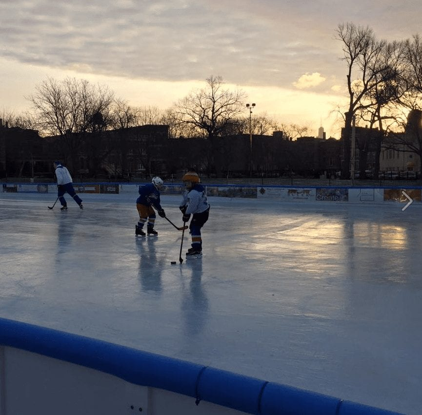 people playing hockey on ice